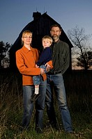 A family stands for their night portrait at Thornhill Farm near Princeton, NE.