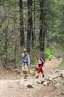 A couple hikes the Colorado Trail along Junction Creek.