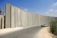 Jerusalem, Israel, A small white car drives along the wall