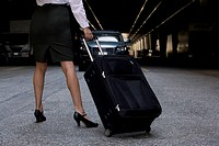 Woman standing with luggage