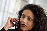 Close up of a business woman talking on a cellphone.
