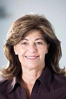 Portrait of a mature business woman smiling.