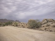USA, Arizona, Scottsdale, dirt road at Jomax Boulders