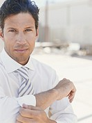 Businessman rolling up sleeves, portrait, close_up