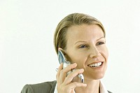 Businesswoman using cell phone, smiling, close-up