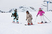 Mother and two kids 6-7 skiing
