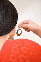 Woman holding earring