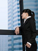 Businesswoman looking through window