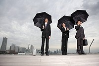 Businesspeople holding umbrellas (thumbnail)