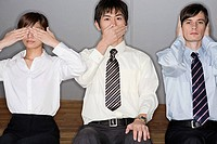 Businesspeople covering their eyes mouths and ears