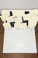 Adhesive notes on a laptop