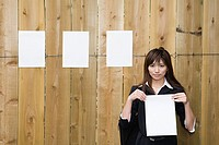 A businesswoman holding paper