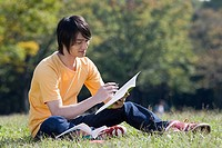 Young man studying in park