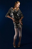Young woman in sequin dress