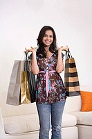 Portrait of a woman holding shopping bags (thumbnail)