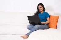 A young woman using a laptop