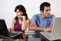 A couple using alaptops