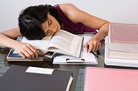 A woman tired from studying