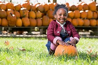 Portrait of a girl and a pumpkin