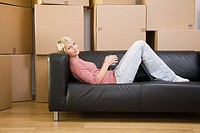 Woman taking a break from moving in (thumbnail)
