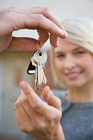 Woman getting house keys (thumbnail)