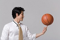 Basketball on man`s finger with smile