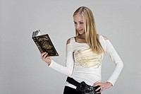 Young woman reading book with smile