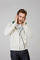 Man listening music with headphone