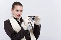 Woman holding and taking picture with camera