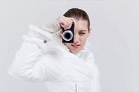 Woman holding digital camera on her eye