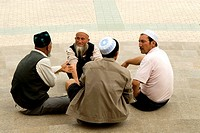 China, Xinjiang, kashgar, group of Uyghur men