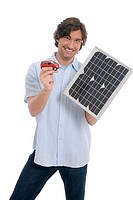 Man holding solar panel and toy car
