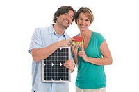 Couple holding solar panel and house (thumbnail)