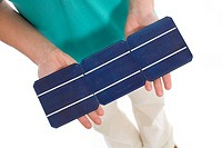 Woman holding solar cell (thumbnail)