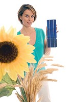Woman holding solar cells, sunflower in foreground