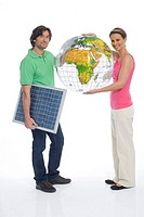 Couple holding solar panel and globe