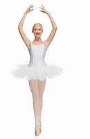 Young ballerina 14_15 standing on pointe in toe shoes,, portrait