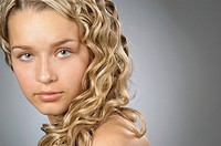Close_up of a young woman with teenage blond hair