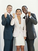 Businessman and businesswoman cheering, smiling