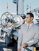 Business man at oil refinery,upper half
