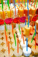 Fruit juices for sale at La Boqueria market, Barcelona. Catalonia, Spain