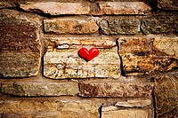 Bit of heart on brick wall