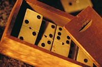 Close-up of dominoes in wooden box