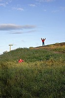 Children playing hide and seek on hill