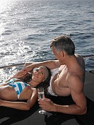 Couple Sunbathing on Boat (thumbnail)