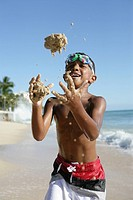 View of a boy playing with sand.