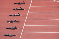 Track and field starting blocks at starting line