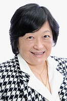 Portrait of middle aged asian woman in business suit