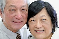 Portrait of senior asian couple in business attire