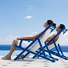 A couple relaxing in deck chairs (thumbnail)